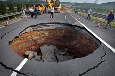 It was sinkholes like this on the road to my ex's apartment that killed my beloved car