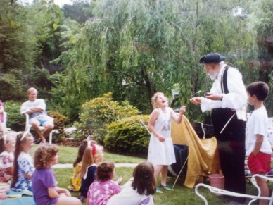 A friend enjoys the magic at my 7th birthday party. 20+ years later, we're still celebrating birthdays together.